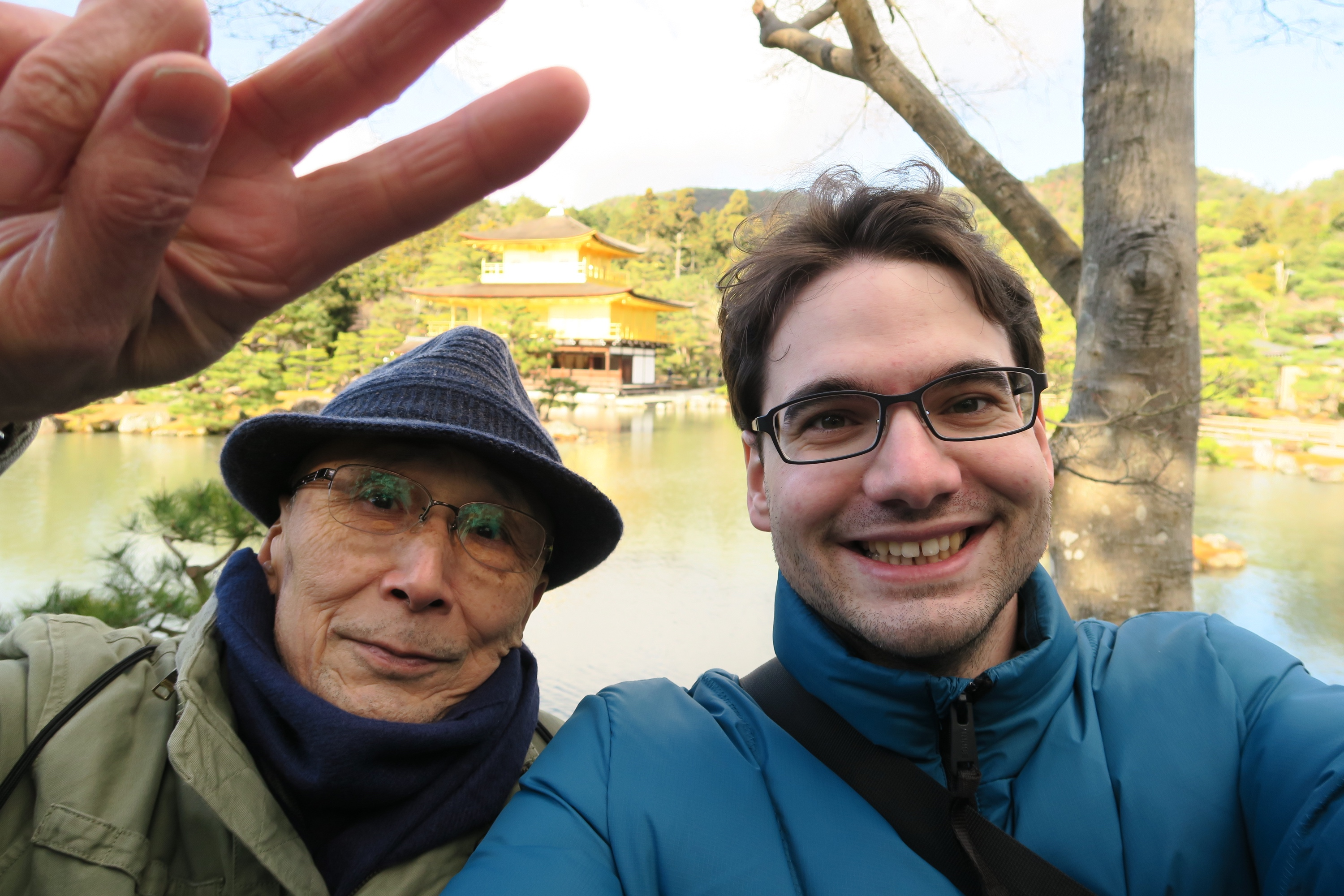 Visiting the Golden Pavilion of Kyoto.
